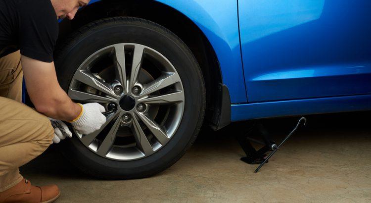 Changing modern car wheel. Man fixing car wheel